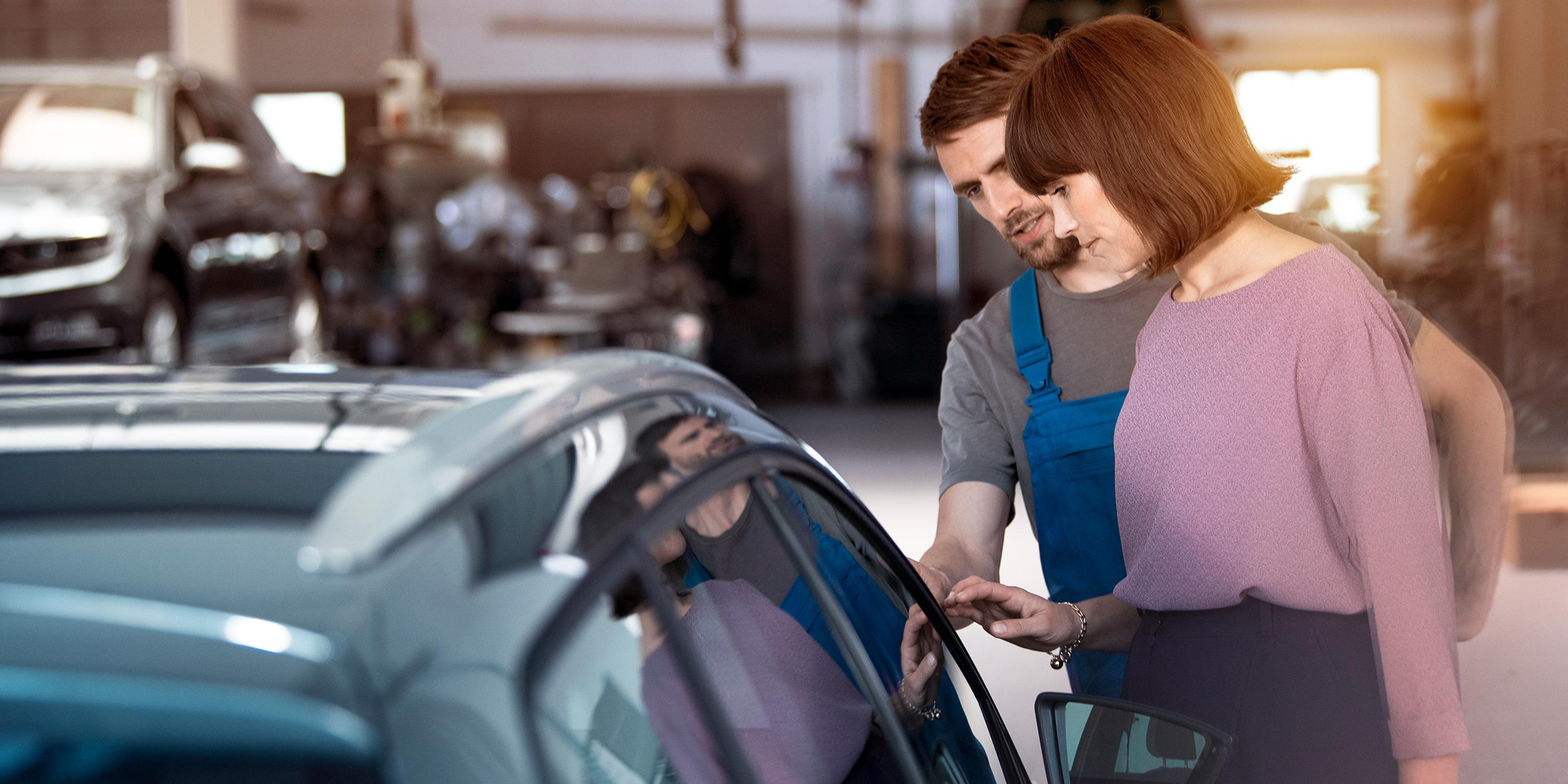 woman mechanic checking car